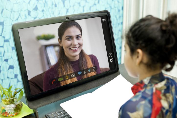 student talking to teacher via video chat